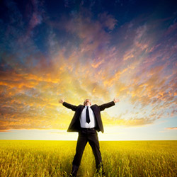 Man with outstretched arms in a field